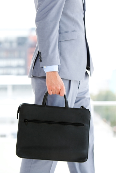 Businessman-Holding-A-Briefcas-7680334