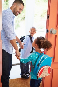 Father Seeing Kids Off To School Before Work