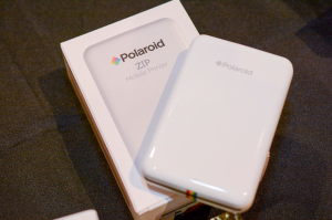 Polaroid Zip Mobile Printer http://www.cnet.com/pictures/instant-prints-from-your-phone-with-polaroids-zip-printer-pictures/